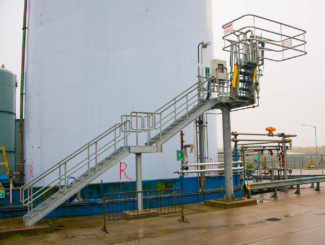 galvanized steel truck loading site with stairs and handrails
