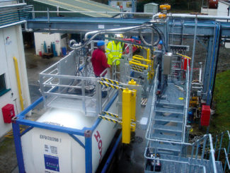 Iso Container loading platform with handrails and loading arm