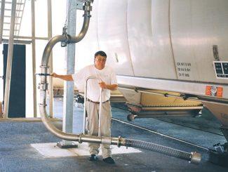 bottom unloading arm for hopper car rail cars.
